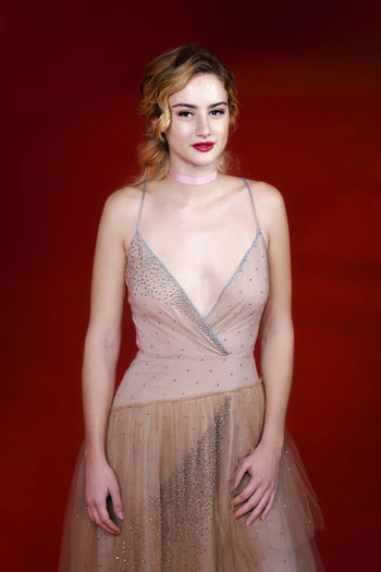 Rome, Italy - October 16, 2016: Actress Grace Van Patten on the red carpet of the 11th edition of the Rome Film Festival to present the film 'Tramps'. Actress Celebrities Cinema Famous People Grace Van Patten; Portrait Red Background Rome Film Festival Uniqueness