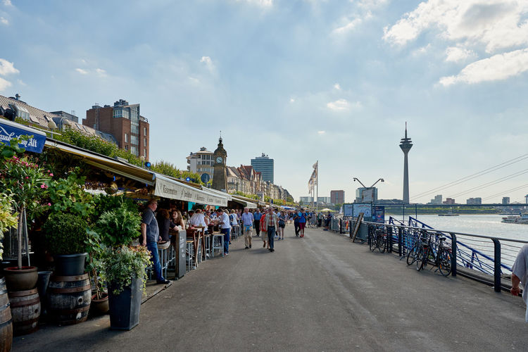 DUESSELDORF, GERMANY - AUGUST 17, 2016: Visitors enjoy the famous Rhine promenade with its many restaurants and bars Altstadt Atmosphere Bar Blu Sky City Life City Street Daytime Düsseldof High Resolution Lifestyles NRW Outdoors People R Relaxing Restaurant Rheinland-Pfalz  Rhine Promna S Shopping Tourism Travel Destinaton