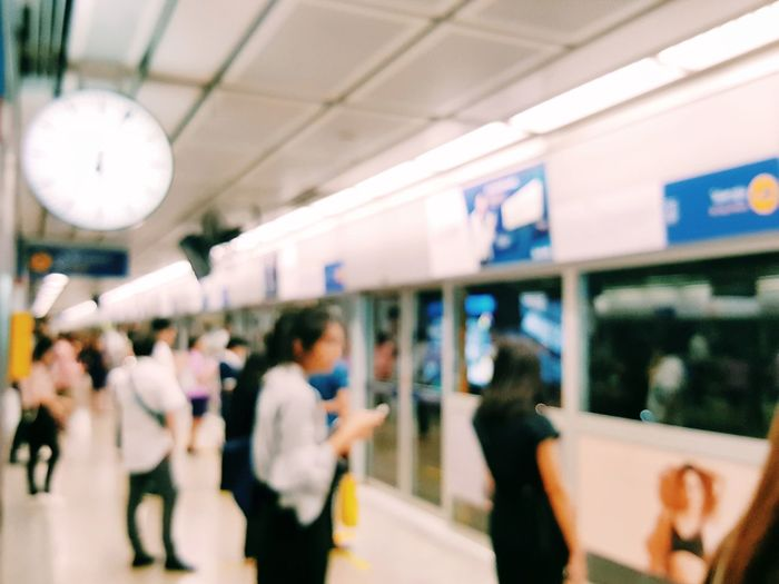 Blurred people on public transportation Blurred Clock Face Clock City Time Crowd Commuter Women Men Commuter Train Group Of People Arrival Departure Board Subway Subway Platform Subway Train Subway Station Station Passenger Train Platform Transportation Building - Type Of Building