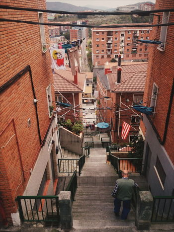 Stairs and Bilbao neighborhood Architecture Building Exterior Built Structure City City Life Day Diminishing Perspective Elevated View Empty Narrow No People Outdoors Residential Building Residential District Residential Structure Roof The Way Forward Town