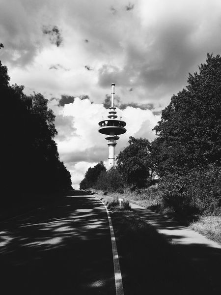 Transportation Road Tree Sky Street Cloudy Cloud - Sky Tower The Way Forward Cloud Outdoors Communications Tower Day Nature Tranquil Scene Non-urban Scene Tranquility Spire  Tall - High Long
