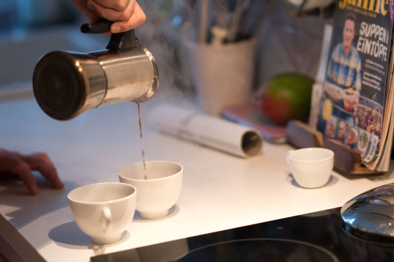 Wake up: pouring coffee from a moka pot Breakfast Caffeine Coffee Coffee Time Espresso Moka Moka Pot Pouring Stove Weekend Bar Cafe Cafe Time Cafeteria Caffè Cappuccino Close-up Coffee Cup Domestic Kitchen Good Morning Indoors  Kitchen Leisure Restaurant Wake Up