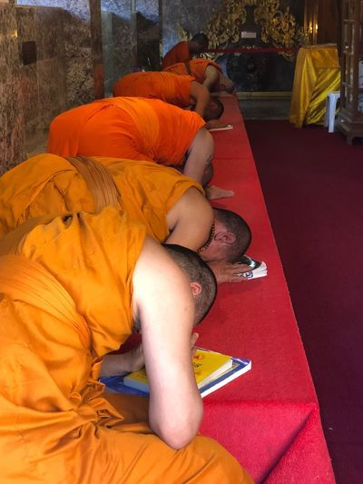 Preghiera Arancione Prospective Buddhist Temple Photography Buddha Real People People Childhood Lifestyles Relaxation Child High Angle View Men Lying Down Sleeping Girls Sitting Orange Color Women Adult Religion Full Length