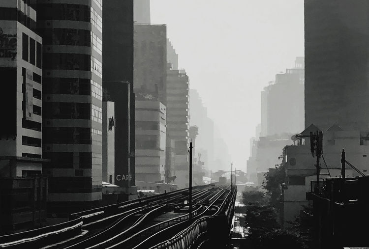 Panoramic view of railroad tracks amidst buildings in city