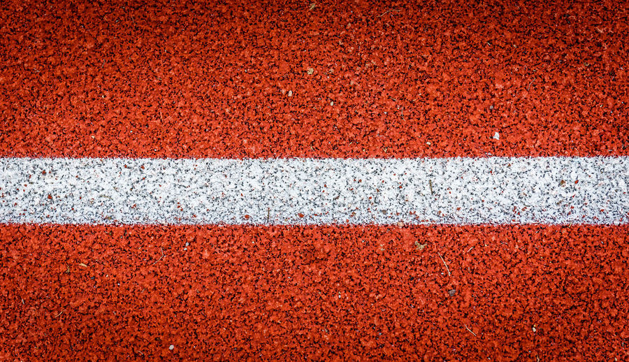 Full frame shot of sports track with white line