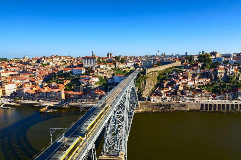 Railway Bridge Over River In City
