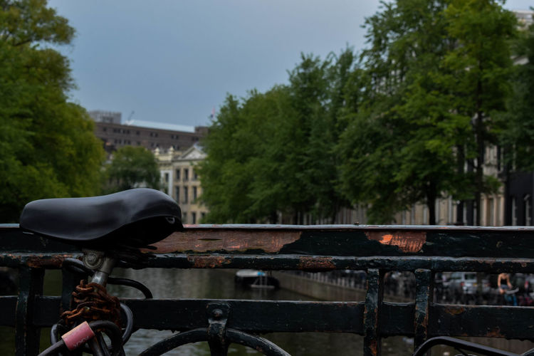 Bicycle by canal in city