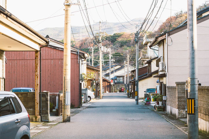The street of Tokyo japan early morning Architecture Building Exterior Built Structure Car City City Life Electricity  Empty Japan Land Vehicle Morning Old Post Residential District Road Road Rope Street Tokyo Transportation