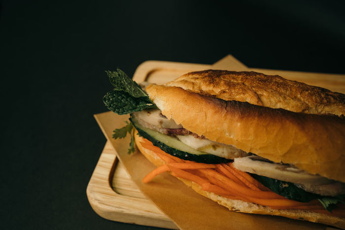 Vietnamese Banh Mi Sandwich Food And Drink Food Freshness Bread Ready-to-eat Indoors  Sandwich Close-up Healthy Eating Black Background Studio Shot Still Life Wellbeing Vegetable No People Meat Fast Food Focus On Foreground Serving Size Processed Meat Snack