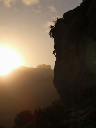 Resting at Sunset Nature Mountains Sunset Sky Mountain Mountains Mountain Adventure Silhouette Sunset Rock - Object Tree Sky Landscape Cliff Steep Climbing Rope Crag Free Climbing Rock Climbing Climbing Geology Climbing Equipment Mountain Climbing Rock Face