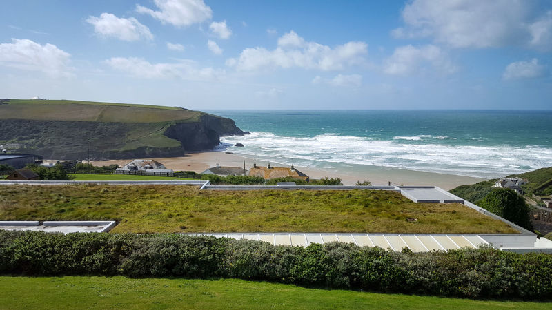 Beach Beauty In Nature Bedruthan Steps Cliff Cloud - Sky Cornwall Day England Grass Horizon Over Water Mawgan Porth Nature No People Outdoors Scenics Sea Sky Water Waves