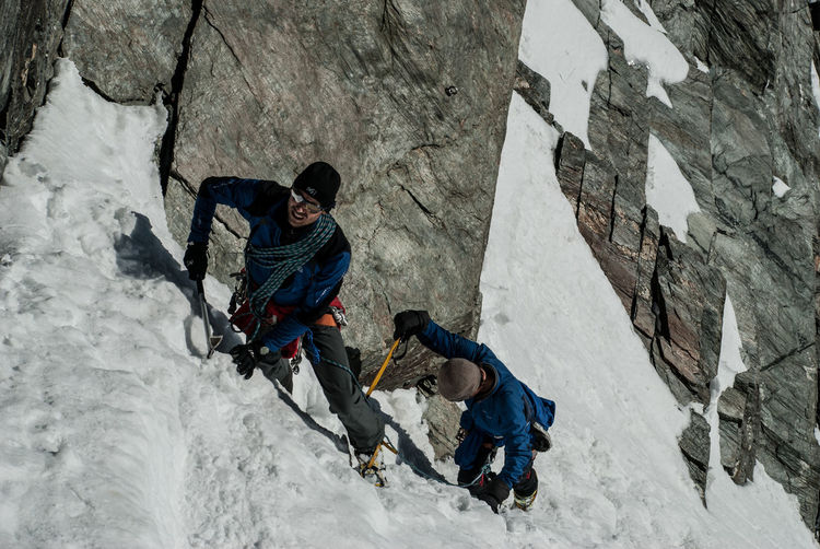Adult Adults Only Adventure Challenge Climbing Climbing Rope Cold Temperature Extreme Sports Full Length Grossglockner Highest Peak Of Austria Men Mountain Mountaineering Only Men Outdoors Peak Ridge Rock - Object Rock Climbing Snow Steep Two People Winter Young Adult