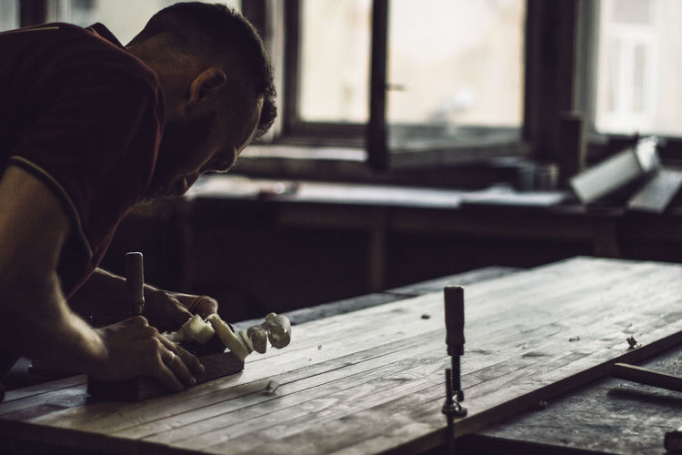 Man working on table at workshop