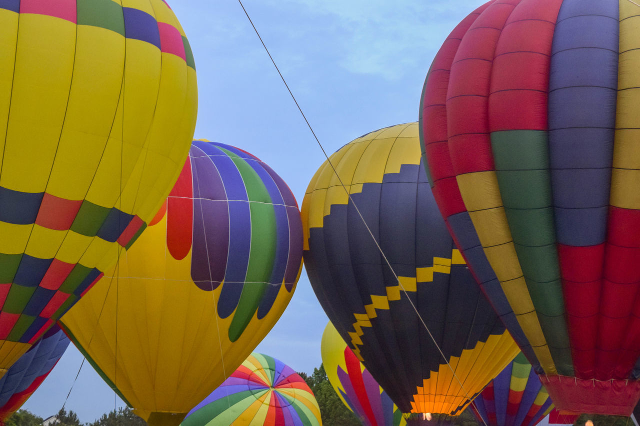 Low Angle View Of Multi Colored Hot Air Balloons Against Sky