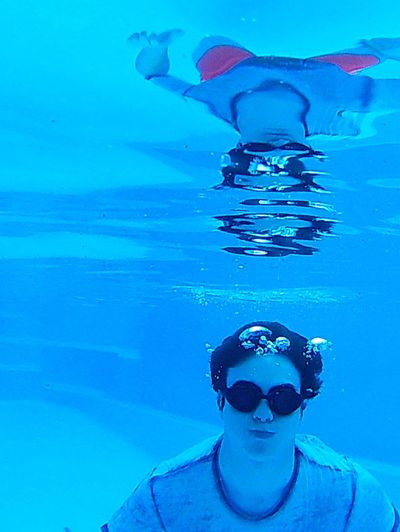 Gazisonit Underwater Reflection Holding Breath Submerged Blue Outdoors One Person Water Swimming Lifestyles Swimming Pool Portrait Day Young Adult