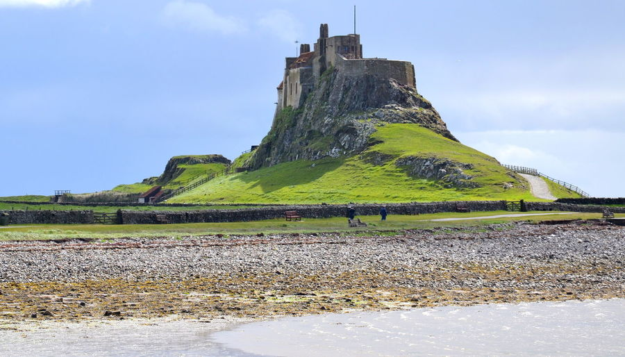 Beauty In Nature Blue Sky Cloud - Sky Day Field History Landscape Lindisfarne Lindisfarne Castle Mountain Nature No People Outdoors Rock - Object Scenics Sky Tranquility Uk Travel