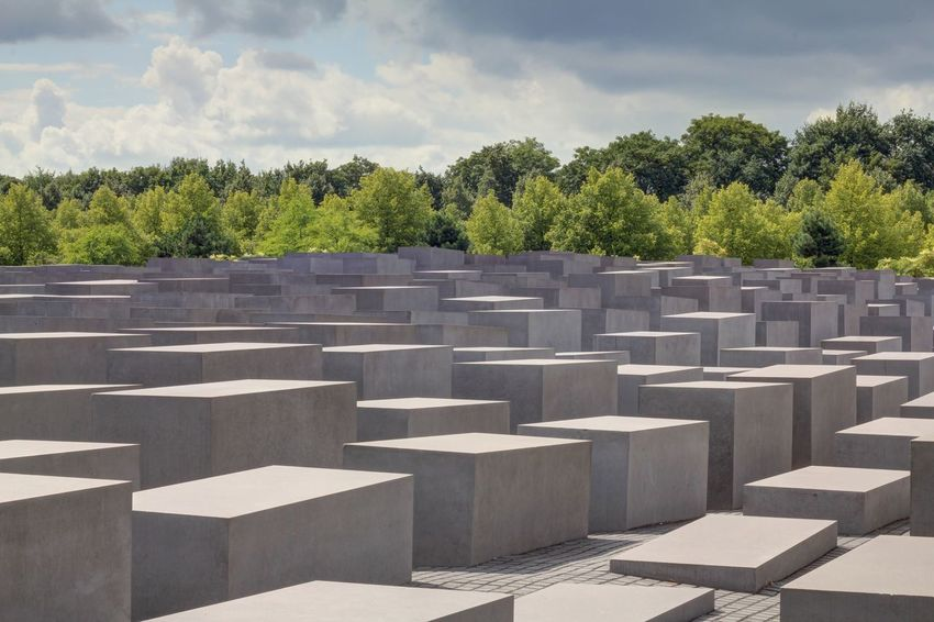Berlin Capital Cities  Cloud - Sky Concrete Day Famous Place Holocaust Holocaust Memorial Berlin Holocaustmemorial In A Row International Landmark Majestic Memories No People Outdoors Repetition Sky Steps Surface Level Tourism Tranquil Scene Tranquility Travel Destinations Tree World War II