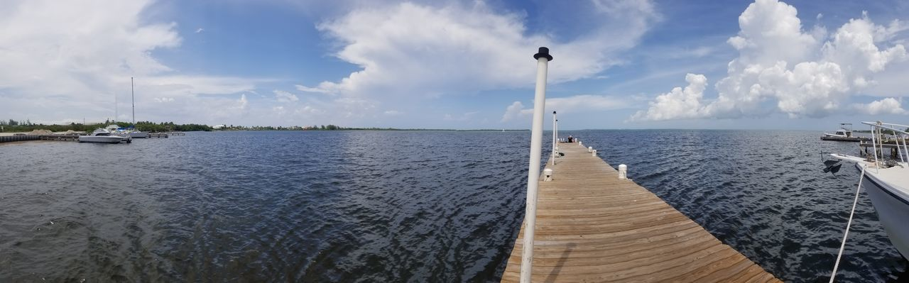 Panoramic view of pier over sea against sky
