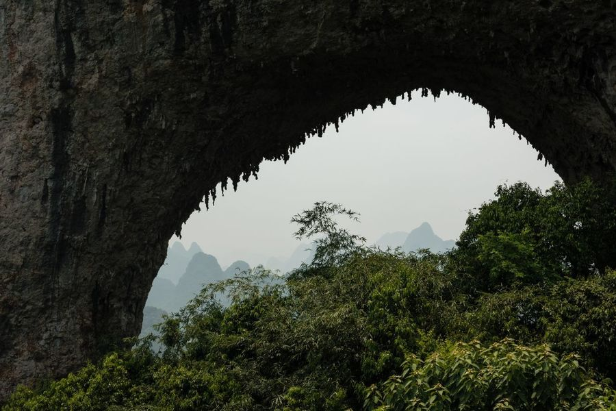 Moon Hill Travel Photography Arch Beauty In Nature Day Indoors  Karst Karst Mountain Looking Through Mountain Natural Arch Nature No People Scenics Tourism Tourist Destination Tranquil Scene Tranquility Tree