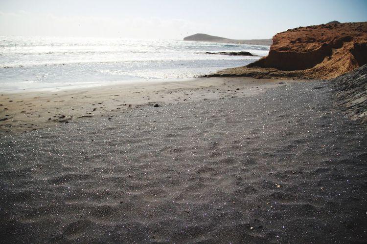 Beach Black Sand Beach Black Sand Shiny Sea Tenerife El Médano The KIOMI Collection Nature Nature's Diversities No People Beach Life