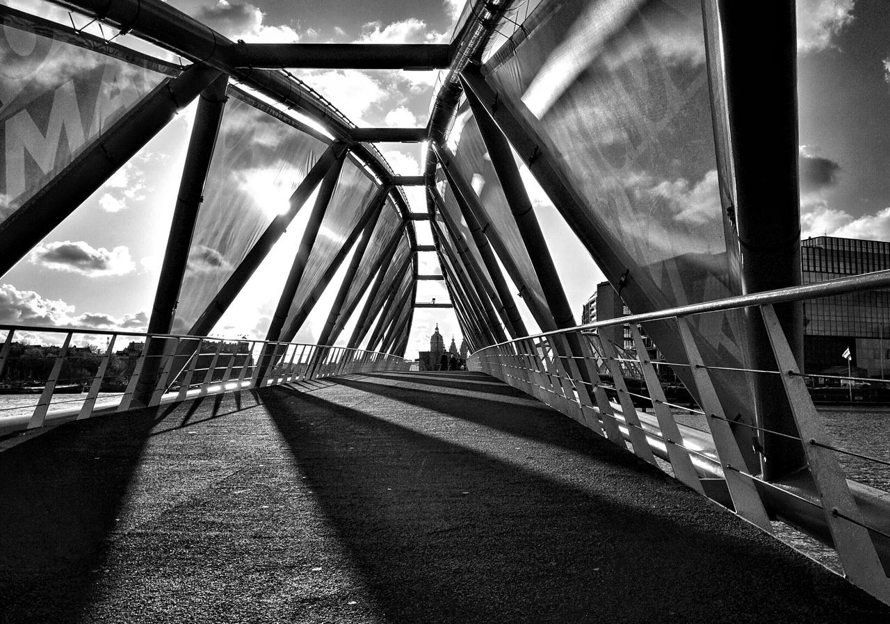 Surface Level Of Road On Bridge Against The Sky