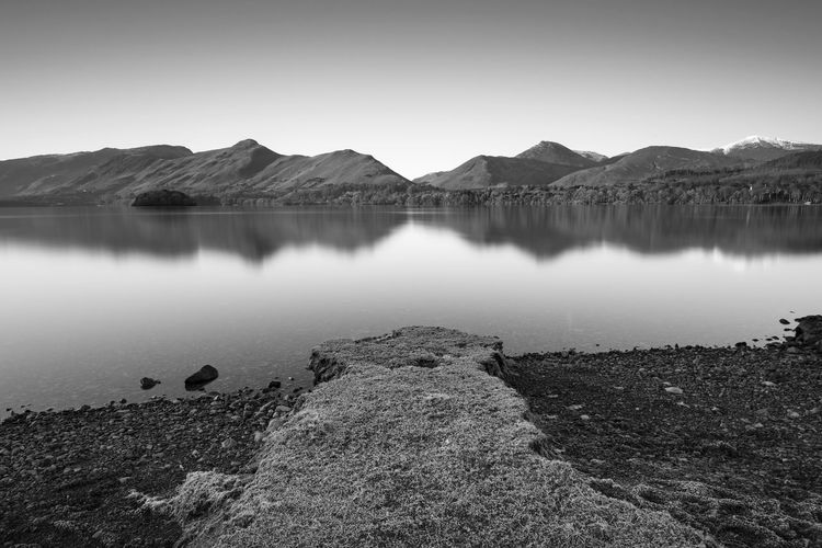 A cold calm Winters morning in the Lake district - Cumbria - UK Calm Canvas Frost Holiday Ice Lake District Reflection Travel Weather Winter Black And White Brochure Cold Lake Landscape Mono Mountain Muted Colors Peaceful Room For Text Season  Shore Snow Still Water Water