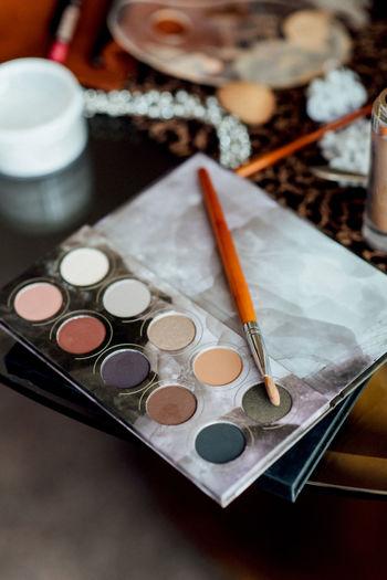 High angle view of make up brush over makeup product