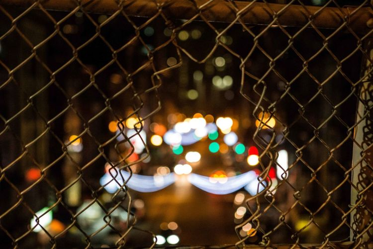 Full frame shot of illuminated chainlink fence