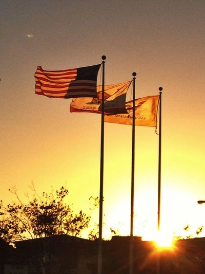 Flags Waving Lookingup Sunset