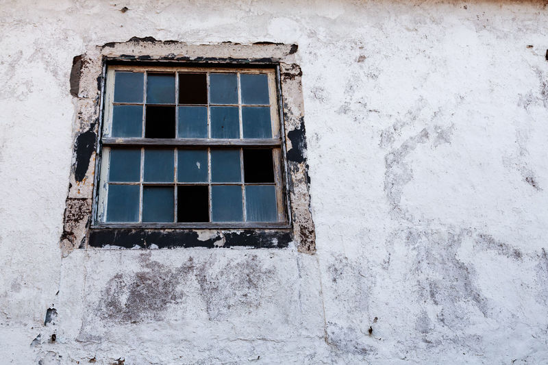 Low angle view of window on abandoned building