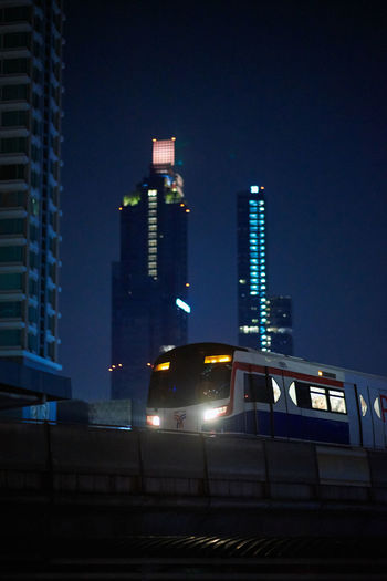 Architecture Built Structure Building Exterior Illuminated Night Building City Sky Office Building Exterior Tall - High No People Skyscraper Low Angle View Tower Nature Public Transportation Outdoors Rail Transportation Office City Life Train Subway