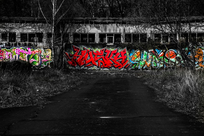 I love the way the graffiti comes out of the black colour! Black&color Colours Black Graffiti Art Graffiti Art Darkness Light And Shadow Nikon Nikonphotography Abonded Abonded Places Abondoned Abondoned Places Nature Shelters Germany Camphitfeld Scary Popular Paint Road EyeEm EyeEm Best Shots Urban