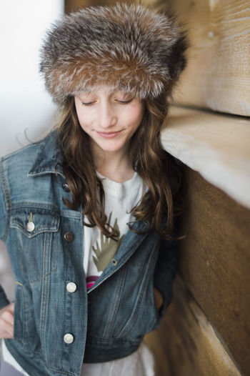 Portrait of smiling girl wearing hat