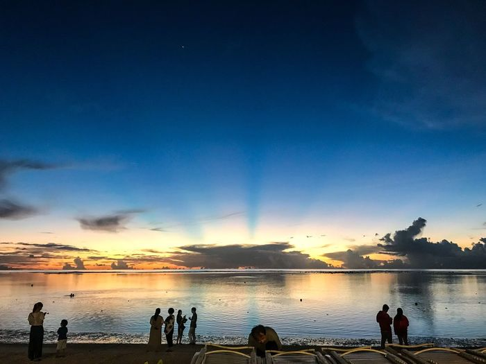 Sea Guam Water Sky Sunset Real People Beauty In Nature Silhouette Sea Scenics - Nature Nature Beach Blue