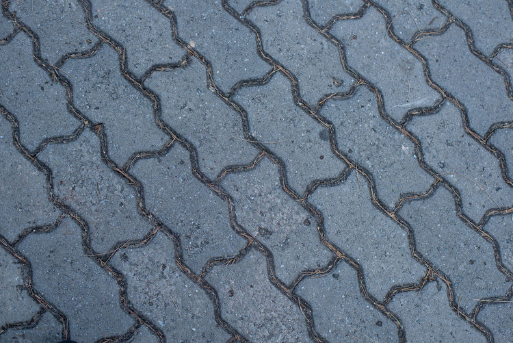 bricks pattern. Full Frame Backgrounds Pattern Textured  No People Day High Angle View Road Footpath Outdoors Street Nature Close-up Land Transportation Cracked Gray Asphalt Paving Stone Rough Arid Climate