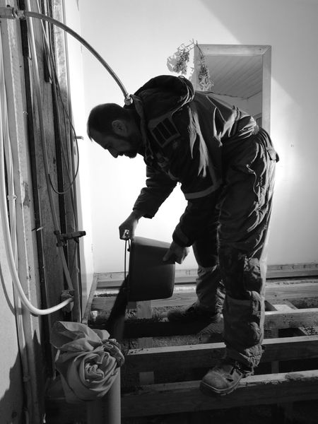 One Man Only One Person Men Indoors  Building Shadow Light And Shadow Blackandwhite Work Working Builder Bucket Pouring Building A House Black & White Contrast Floor Mirror