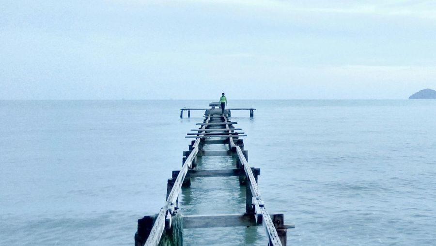 View Of Jetty In Sea Against Clear Sky