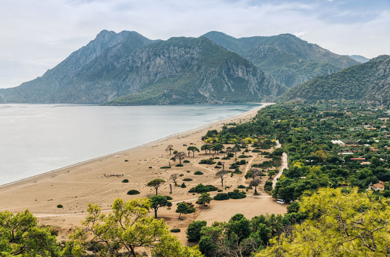 Scenic view of beach and mountains