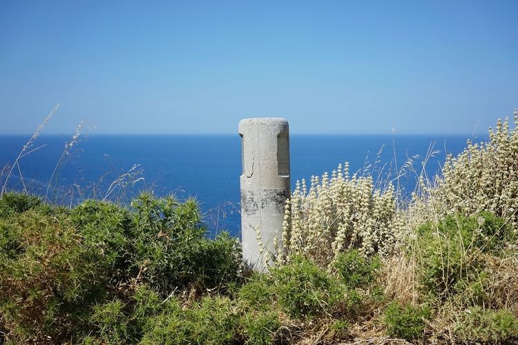 Crete Milestone Water Sea Sky Plant Clear Sky Nature Day Horizon Over Water Horizon Scenics - Nature No People Beauty In Nature Blue Copy Space Outdoors Tranquility Sunlight