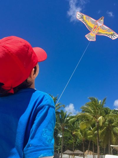 Volantin Tree Blue Sky Real People Nature Plant Leisure Activity One Person Lifestyles Men Childhood Casual Clothing Hat Child Clear Sky Day Palm Tree Headshot