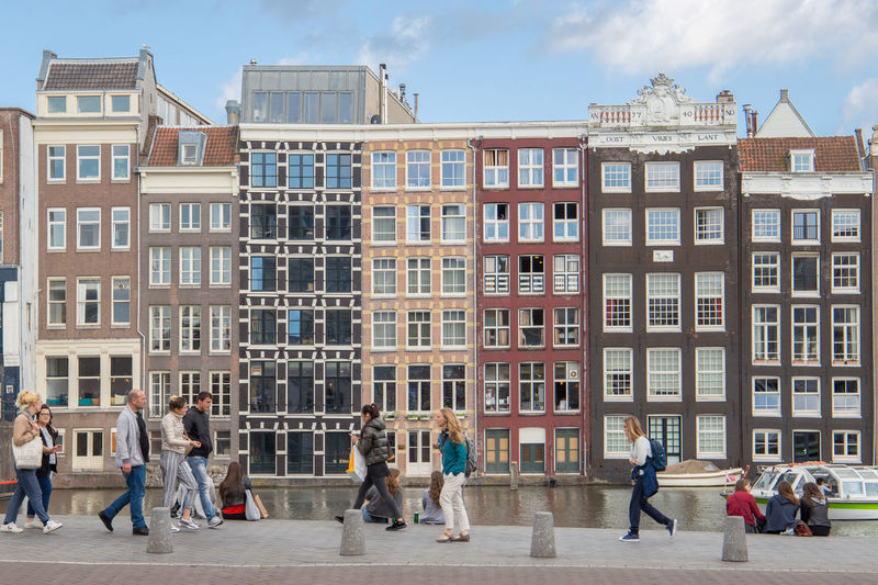 Amsterdam Netherlands Architecture Building Building Exterior Built Structure City Damrak Day Dutch Houses Education Group Group Of People Holland Medium Group Of People Men Nature Outdoors People Real People Sky Street Tourism Walking Window Women