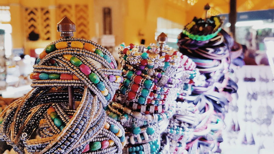 Close-up of bangles for sale in market