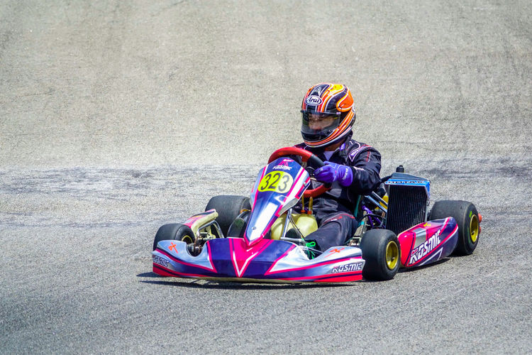 Go kart racer plactising on the track Auto Racing Colorful Competition Day Go Kart Headwear Motorsport One Person Outdoors People Sport Sports Clothing Sports Helmet Sports Race Sports Track