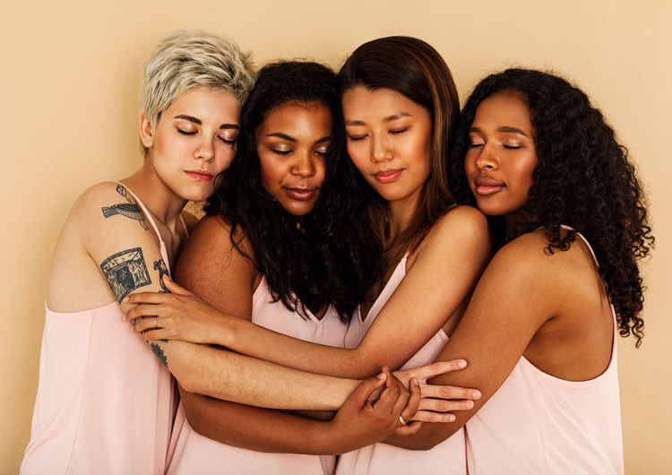 Friendship Group Of People Indoors  Togetherness People Embracing Hairstyle Diversity 4 People Eyes Closed  Different Skin Asian  Caucasian African American Mixed Race Females Women Studio Shot Multi Ethnic Young International Women's Day 2019