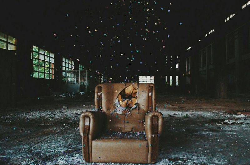 Abandoned Armchair In Dark Room
