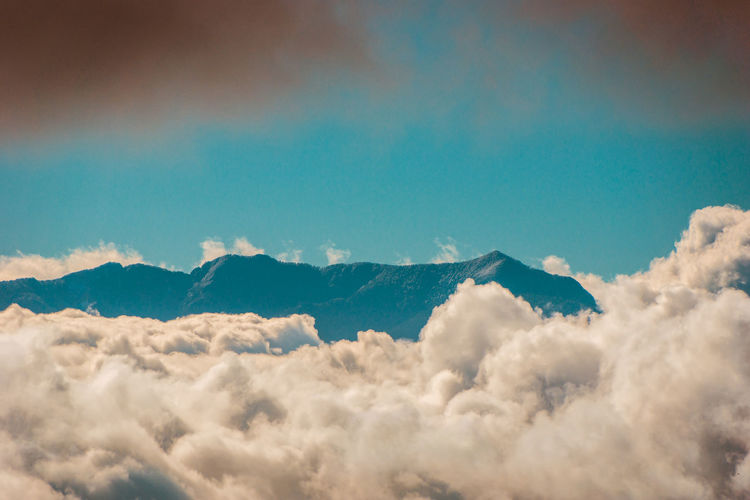 The Heaven... EyeEmNewHere Above Atmosphere Beauty In Nature Blue Cloud - Sky Cloudscape Copy Space Day Environment Fluffy Heaven Idyllic Meteorology Mountain Mountain Peak Nature No People Outdoors Scenics Scenics - Nature Sky Softness Tranquil Scene Tranquility