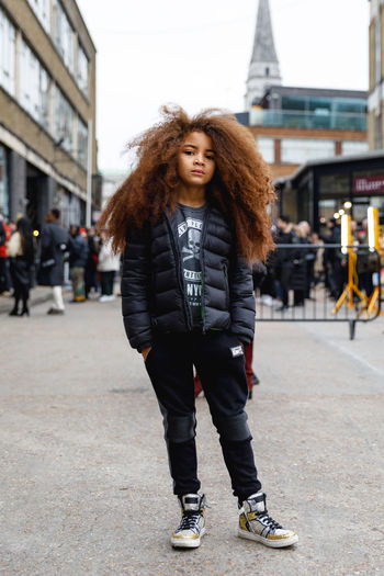 London Fashion Week Mens 2019 Redefining Menswear One Person Full Length Portrait Hair Standing Lifestyles Curly Hair Young Adult Front View Hairstyle Leisure Activity Looking At Camera Architecture Building Exterior Real People City Long Hair Outdoors Warm Clothing Teenager Young Men Fashion Fashion Photography London British Culture
