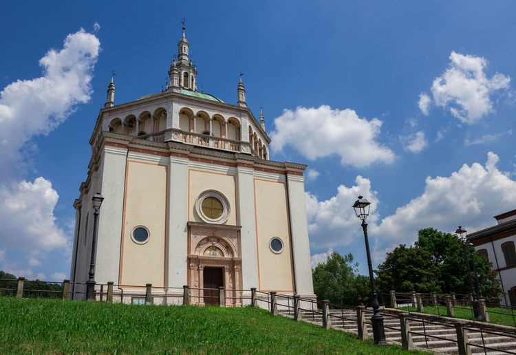 Church of Crespi d'Adda in Capriate San Gervasio, Bergamo - Italy. Ancient Architecture Bell Bergamo Church City Concepts Crespi Dadda God Green Holiday Industrial Jesus Lombardy Worker Background Blue Building Clouds Dome Europe Heritage Historic Italy