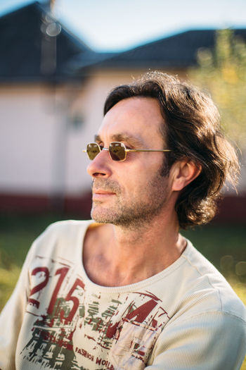 Portrait of mid adult man wearing sunglasses