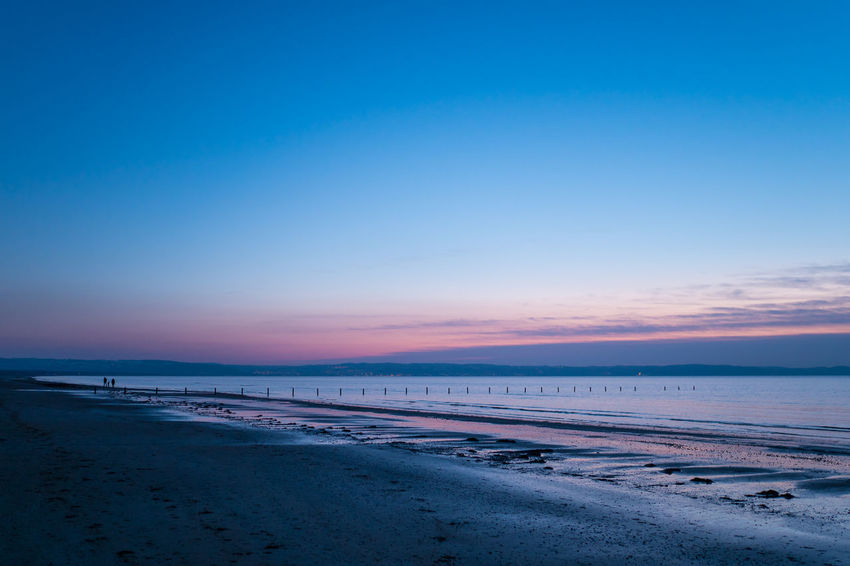 At the beach in the blue hour People Silhouette Water Sunset Beach Sea Sand Sunset Blue Water Horizon Over Water Sky Scenics Landscape Beauty In Nature Outdoors Nature